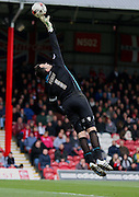 David Forde finger tip save to keep Millwall in the game during the Sky Bet Championship match between Brentford and Millwall at Griffin Park, London, England on 21 March 2015. Photo by Matthew Redman.