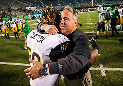 Nov 25, 2017; Huntington, WV, USA; Southern Miss Golden Eagles head coach Jay Hopson celebrates with Southern Miss Golden Eagles defensive lineman Rod Crayton (90) after beating the Marshall Thundering Herd at Joan C. Edwards Stadium. Mandatory Credit: Ben Queen-USA TODAY Sports