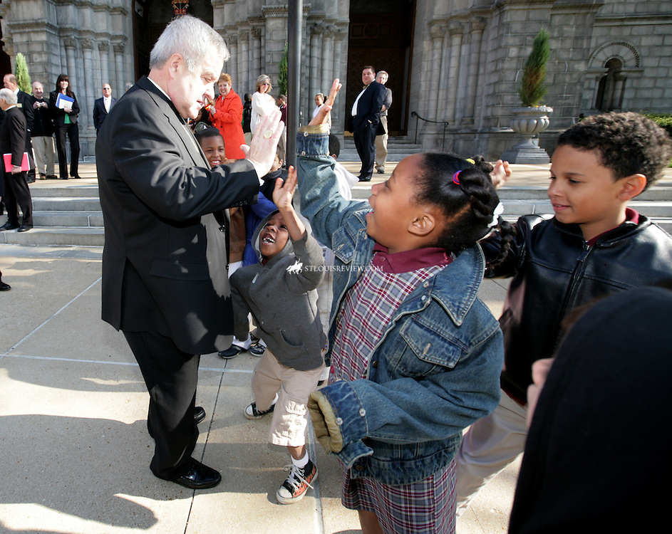 TUESDAY, APRIL 21, 2009 - Children at Cathedral Basilica greated Archbishop-elect Robert J. Carlson as he toured the archdiocese...©Photo by Jerry Naunheim Jr.... ..