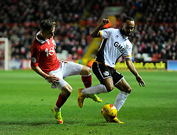 Bristol City's Joe Bryan tackles Port Vale's Byron Moore  - Photo mandatory by-line: Joe Meredith/JMP - Mobile: 07966 386802 - 10/02/2015 - SPORT - Football - Bristol - Ashton Gate - Bristol City v Port Vale - Sky Bet League One
