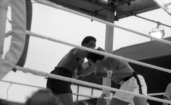 Ali vs Lewis Fight, Croke Park,Dublin..1972..19.07.1972..07.19.1972..19th July 1972..As part of his built up for a World Championship attempt against the current champion, 'Smokin' Joe Frazier,Muhammad Ali fought Al 'Blue' Lewis at Croke Park,Dublin,Ireland. Muhammad Ali won the fight with a TKO when the fight was stopped in the eleventh round...Image of Lewis throwing a left as Ali ducks to avoid the blow.