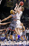 SOUTH BEND, IN - JANUARY 12: Dane Goodwin #23 of the Notre Dame Fighting Irish shoots the ball as Ky Bowman #0 of the Boston College Eagles reaches for the block at Purcell Pavilion on January 12, 2019 in South Bend, Indiana. (Photo by Michael Hickey/Getty Images) *** Local Caption *** Dane Goodwin; Ky Bowman