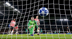 PSV Eindhoven's goalkeeper Jeroen Zoet (centre) reacts after Tottenham Hotspur's Lucas Moura (back) scores his side's first goal of the game