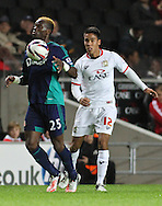 Picture by David Horn/Focus Images Ltd +44 7545 970036.25/09/2012.Adam Chicksen of Milton Keynes Dons and Louis Saha (l) of Sunderland during the Capital One Cup match at stadium:mk, Milton Keynes.