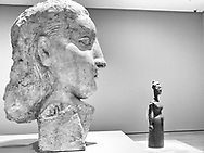 Head Of A Woman and Woman in a Long Dress - sculptures from the war years, 1939-1945 by Pablo Picasso; Picasso Sculpture exhibit at MoMA.