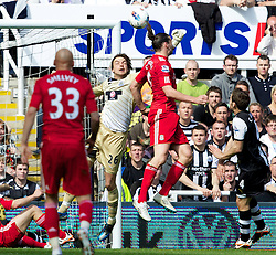 NEWCASTLE-UPON-TYNE, ENGLAND - Sunday, April 1, 2012: Liverpool's Andy Carroll in action against Newcastle United's goalkeeper Tim Krul during the Premiership match at St James' Park. (Pic by Vegard Grott/Propaganda)