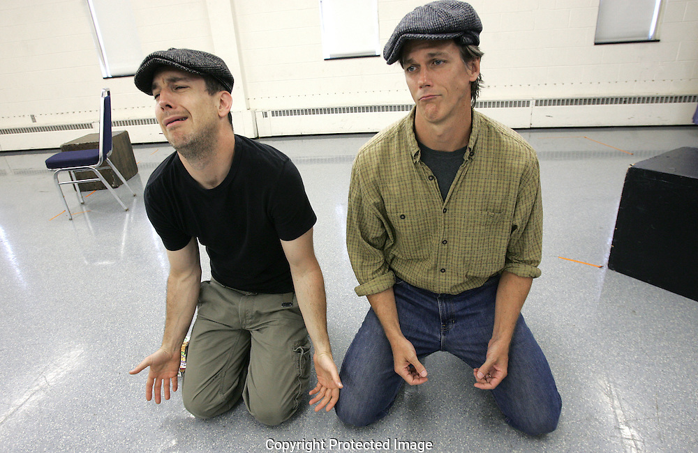 Actors Jon Osbeck (left) and Kevin McClatchy try to look dispossessed as they rehearse a two man play called Stones In His Pockets, by Marie Jones, directed by Jimmy Bohr. The play will run June 19-29 at MadLab Theatre. The two actors play 15 different characters collectively.