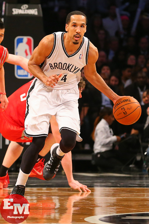 Apr 1, 2014; Brooklyn, NY, USA; Brooklyn Nets guard Shaun Livingston (14) dribbles the ball up the court during the fourth quarter of their game against the Houston Rockets at Barclays Center. The Nets defeated the Rockets 105-96.