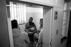 June 30, 2013 - Cape Town, South Africa - U.S. President BARACK OBAMA and First Lady MICHELLE OBAMA, along with daughters SASHA and MALIA, stand in former South African President Nelson Mandela's cell as they listen to former prisoner AHMED KATHRADA during their tour of Robben Island Prison on Robben Island of Cape Town. (Credit Image: © Pete Souza/The White House/ZUMAPRESS.com)