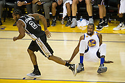 Golden State Warriors forward Kevin Durant (35) is tangled up with San Antonio Spurs forward Kawhi Leonard (2) after a missed lay up at Oracle Arena in Oakland, Calif., on October 25, 2016. (Stan Olszewski/Special to S.F. Examiner)
