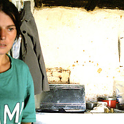 A widow of war in Kosovo. Many widows are left without any means of sustainment.  After the war,  ngos assisted some widows of war in rebuilding their homes however support has diminuished to null after they have been moved to  Iraq and Afghanistan.  This policy has left the widows in unfinished homes and no one to turn to for support.