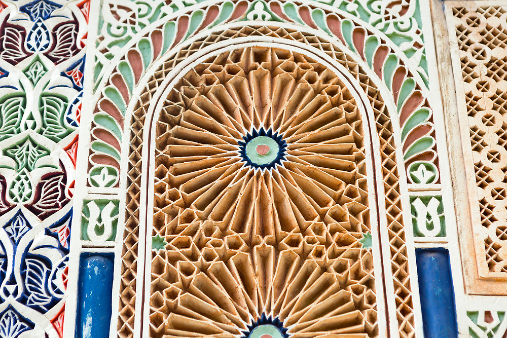 """Moroccan zellije mosaic wall / doorway tiling, Bahia Palace, Marrakesh, Morocco, 2016–04-21.<br /><br />The name Bahia means """"brilliance"""" and the Bahia palace was built with the intention of being the most brilliant palace of its time. Built by two different generations - Si Moussa and his son, the layout and overall design is slightly random and unorganised. The materials used to make the intricate displays of zelij, ceramic and wood work through out the palace were sourced from across the Maghreb."""