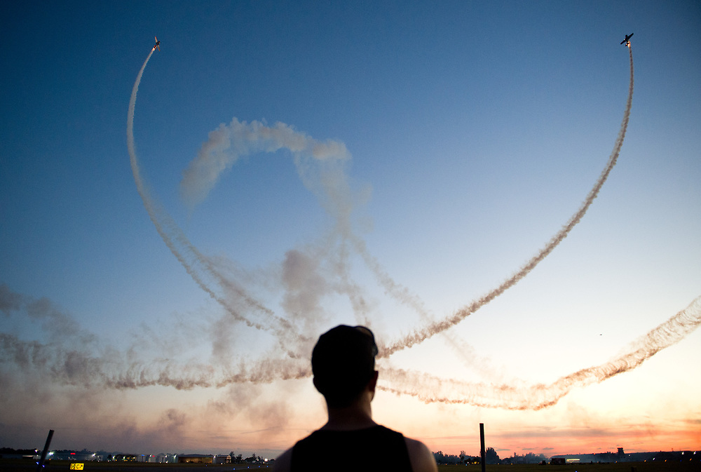 Xavier Mascareñas/Treasure Coast Newspapers; Ricky Steade, 15, of West Palm Beach, watches the Friday Night Air Show on Oct. 30, 2015, at Witham Field in Stuart. The night's events kicked off the weekend's Stuart Air Show at Witham Field.