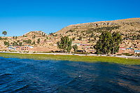 Titicaca Lake shoreline in the peruvian Andes at Puno Peru