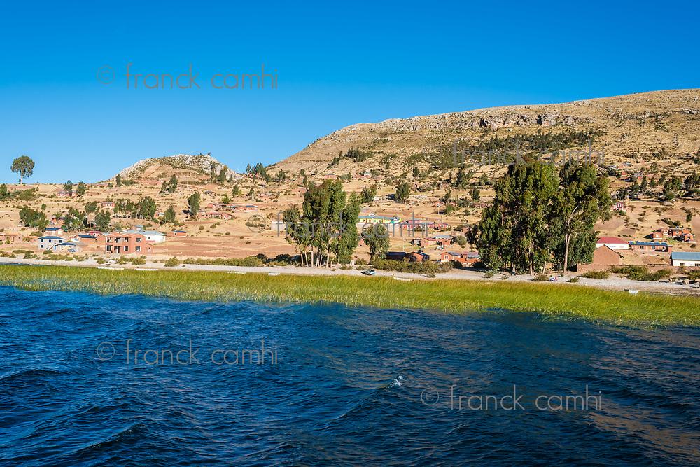 Titicaca Lake shoreline in the peruvian Andes at Puno Peru