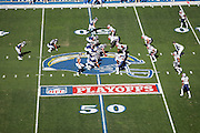 SAN DIEGO - JANUARY 14:  Overhead general view of the opposing teams on the mid-field NFL Playoff logo as quarterback Philip Rivers #17 of the San Diego Chargers get set for the snap near the 50 yard line against the New England Patriots at the AFC Divisional Playoff Game held on January 14, 2007 at Qualcomm Stadium in San Diego, California. The Patriots defeated the Chargers 24-21. ©Paul Anthony Spinelli *** Local Caption *** Philip Rivers