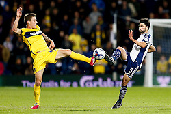 Josh Ruffels of Oxford United and Claudio Yacob of West Brom compete for the ball - Photo mandatory by-line: Rogan Thomson/JMP - 07966 386802 - 26/08/2014 - SPORT - FOOTBALL - The Hawthorns, West Bromwich - West Bromwich Albion v Oxford United - Capital One Cup Round 2.