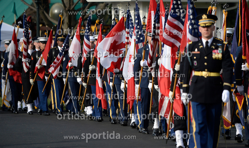 Honor guards carry US and Canadian flags at the White House as part of the official Arrival Ceremony opening the Official Visit of Prime Minister Justin Trudeau and Mrs. Sophie Gr&eacute;goire Trudeau of Canada on the South Lawn of the White House in Washington, DC on Thursday, March 10, 2016. EXPA Pictures &copy; 2016, PhotoCredit: EXPA/ Photoshot/ Olivier Douliery<br /> <br /> *****ATTENTION - for AUT, SLO, CRO, SRB, BIH, MAZ, SUI only*****