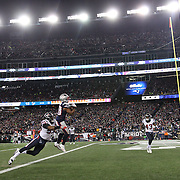 FOXBOROUGH, MASSACHUSETTS - JANUARY 14:  Running back James White #28 of the New England Patriots scores a touchdown while challenged by inside linebacker Benardrick McKinney #55 of the Houston Texans during the Houston Texans Vs New England Patriots Divisional round game during the NFL play-offs on January 14th, 2017 at Gillette Stadium, Foxborough, Massachusetts. (Photo by Tim Clayton/Corbis via Getty Images)