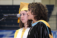 Alter principal Lourdes Lambert (right) introduces Valedictorian Alexandra Ricard during the 47th commencement excercise of Archbishop Alter High School at Trent Arena in Kettering, Saturday, May 26, 2012.