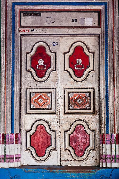 Painted door. Home in Nagore. East Coast.