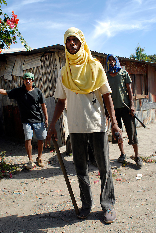 Members of Dili gangs play games of cat and mouse with Malaysian military as they head to Comora to look for trouble.