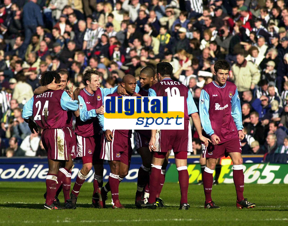 Photo: Greig Cowie<br />Barclaycard Premiership. West Bromwich Albion v West Ham United, 23/02/2002<br />The West Ham players surround Trevor Sinclair to show how much his goal means to the team