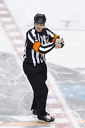 Dec 21, 2011; San Jose, CA, USA; NHL referee Dave Jackson (8) calls a holding penalty on San Jose Sharks left wing Torrey Mitchell (not pictured) during the first period against the Tampa Bay Lightning at HP Pavilion. San Jose defeated Tampa Bay 7-2. Mandatory Credit: Jason O. Watson-US PRESSWIRE