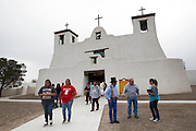 People depart from Mass at St. Augustine Mission in the Pueblo of Isleta in New Mexico Nov. 2, the feast of All Souls. The establishment of the mission dates to 1613. The first church was found in ruins following the Pueblo Indian Revolt and was rebuilt in 1716.