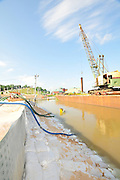 8/11/11} Vicksburg} -- Vicksburg, MS, U.S.A. -- Pictured is Ergon Marine and Industrial Suppy company working around the clock to sand bag their property from the rising flood water. In one photo an Ergon employes removes  snake from climbing the sand bag levee.  c. Vicks burg a riverfront town steeped in war and sacrifice, gets set to battle an age-old companion: the Mississippi River. The city that fell to Ulysses S. Grant and the Union Army after a painful siege in 1863 is marshalling a modern flood-control arsenal to keep the swollen Mississippi from overwhelming its defenses. -- ...Photo by Suzi Altman, Freelance.
