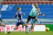 Derby's Johnny Russell (7) avoids the challenge from Wigan's Max Power (6) during the EFL Sky Bet Championship match between Wigan Athletic and Derby County at the DW Stadium, Wigan, England on 3 December 2016. Photo by Craig Galloway.