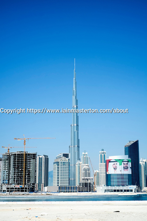 View of new skyline of Dubai at Business Bay with Burj Khalifa tower in United Arab Emirates UAE Middle East