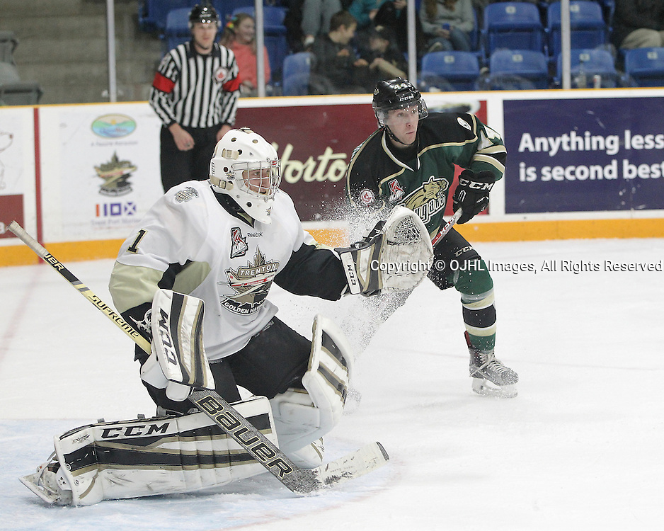 TRENTON, ON  - DEC 9,  2016: Ontario Junior Hockey League game between Cobourg and Trenton, Chris Janzen #1 of the Trenton Golden Hawks makes the save as Ryan Casselman #44 of the Cobourg Cougars deflects the puck during the third period.<br /> (Photo by Tim Bates / OJHL Images)