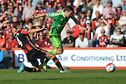 AFC Bournemouth's midfielder Dan Gosling tackles Sunderland AFC midfielder Adam Johnson during the Barclays Premier League match between Bournemouth and Sunderland at the Goldsands Stadium, Bournemouth, England on 19 September 2015. Photo by Mark Davies.