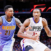 02 October 2015: Los Angeles Clippers guard Wesley Johnson (33) drives past Denver Nuggets forward Wilson Chandler (21) during the Los Angeles Clippers 103-96 victory over the Denver Nuggets, in a preseason game, at the Staples Center, Los Angeles, California, USA.