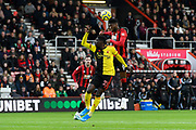 Jefferson Lerma (8) of AFC Bournemouth leaps up above Ismaïla Sarr (23) of Watford to head the ball during the Premier League match between Bournemouth and Watford at the Vitality Stadium, Bournemouth, England on 12 January 2020.