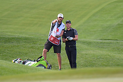 May 2, 2019 - Charlotte, NC, U.S. - CHARLOTTE, NC - MAY 02: Keith Mitchell takes advice from his caddy as he looks over his approach to the 14th green during the first round of the Wells Fargo Championship at Quail Hollow on May 2, 2019 in Charlotte, NC. (Photo by William Howard/Icon Sportswire) (Credit Image: © William Howard/Icon SMI via ZUMA Press)