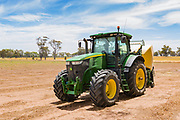 John Deere 7280R tractor with Krone hay baler in a field near Nurrabiel, Victoria, Australia. <br />