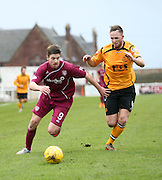 Arbroath's Greg Rutherford goes past Annan's Martin McNiff - Arbroath v Annan Athletic, Ladbrokes SPFL League two at Gayfield<br /> <br />  - &copy; David Young - www.davidyoungphoto.co.uk - email: davidyoungphoto@gmail.com