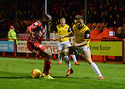 Northampton  midfielder Lawson D'Ath takes on Crawley midfielder Lewis Young before being fouled for a penalty during the Sky Bet League 2 match between Crawley Town and Northampton Town at the Checkatrade.com Stadium, Crawley, England on 24 November 2015. Photo by David Charbit.