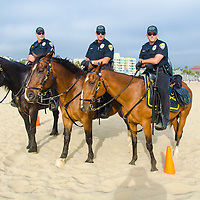 Santa Monica Police Officers on horses and bicycles patrol Santa Monica Beach during Pandora's summer concert featuring this year's hottest pop artists Iggy Azalea, MAGIC!, and Rita Ora at the Santa Monica Pier on Saturday, August 9, 2014.