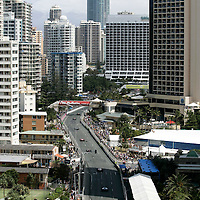 20-22 October, 2006, Surfers Paradise, Queensland, Australia.<br /> The field heads past the second chicane toward the Q1 tower at the start.<br /> &copy; 2006 Phillip Abbott/USA<br /> LAT Photographic