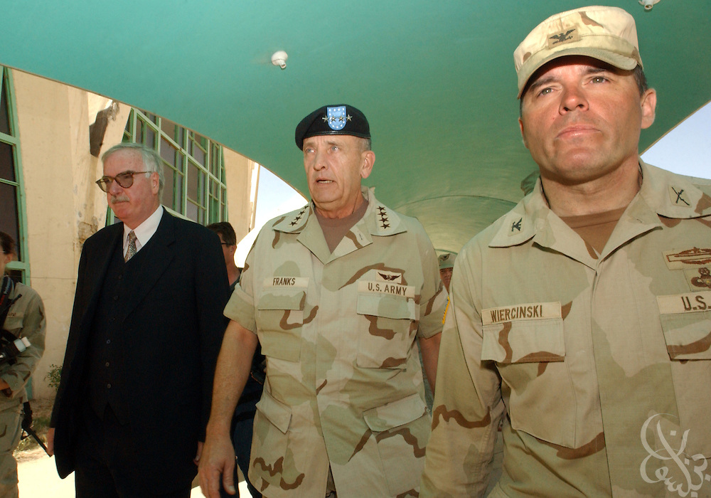 U.S. Commander of Central Command, Gen. Tommy Franks (c) is escorted to meet with U.S. and coalition troops by 101st Airborne 3rd Brigade commander Col. Frank Wiercinski (r)May 15, 2002 at Kandahar airbase in southern Afghanistan. Franks stopped at the base to personally address the troops deployed there as part of Operation Enduring Freedom.