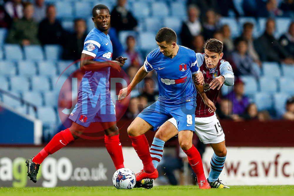 Lloyd James of Leyton Orient is challenged by Ashley Westwood of Aston Villa - Photo mandatory by-line: Rogan Thomson/JMP - 07966 386802 - 27/08/2014 - SPORT - FOOTBALL - Villa Park, Birmingham - Aston Villa v Leyton Orient - Capital One Cup Round 2.