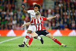 Matt Targett of Southampton is tackled by Isaiah Brown of Vitesse Arnhem - Mandatory by-line: Jason Brown/JMP - Mobile 07966386802 - 31/07/2015 - SPORT - FOOTBALL - Southampton, St Mary's Stadium - Southampton v Vitesse Arnhem - Europa League