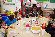 D.C. Public Schools Chancellor Kaya Henderson talks to preschool students Karla Rodriguez, right, and Leonel Ventura at Truesdell Education Campus on Friday, Nov. 16, 2012 in Washington, D.C. Henderson recently announced that she plans to close 20 under-enrolled schools across the district. CREDIT: Lexey Swall for The Wall Street Journal