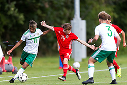 WREXHAM, WALES - Thursday, August 15, 2019: Wales' Paige Wilding and Northern Ireland's Kenny Ximines during the UEFA Under-15's Development Tournament match between Wales and Northern Ireland at Colliers Park. (Pic by Paul Greenwood/Propaganda)