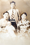 young adult family group studio portrait ca 1930s Japan