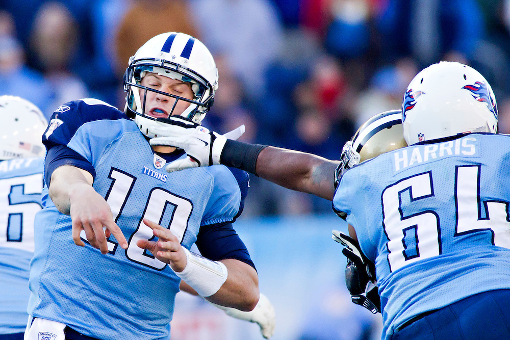 NASHVILLE, TN - DECEMBER 11:   Jake Locker #10 of the Tennessee Titans throws a pass under pressure against the New Orleans Saints at LP Field on December 11, 2011 in Nashville, Tennessee.  The Saints defeated the Titans 22-17.  (Photo by Wesley Hitt/Getty Images) *** Local Caption *** Jake Locker