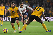 Harry Winks midfielder of Tottenham Hotspur (8) battles with Wolverhampton Wanderers defender Willy Boly (15) and Wolverhampton Wanderers defender Jonny Castro (19) during the Premier League match between Wolverhampton Wanderers and Tottenham Hotspur at Molineux, Wolverhampton, England on 3 November 2018.